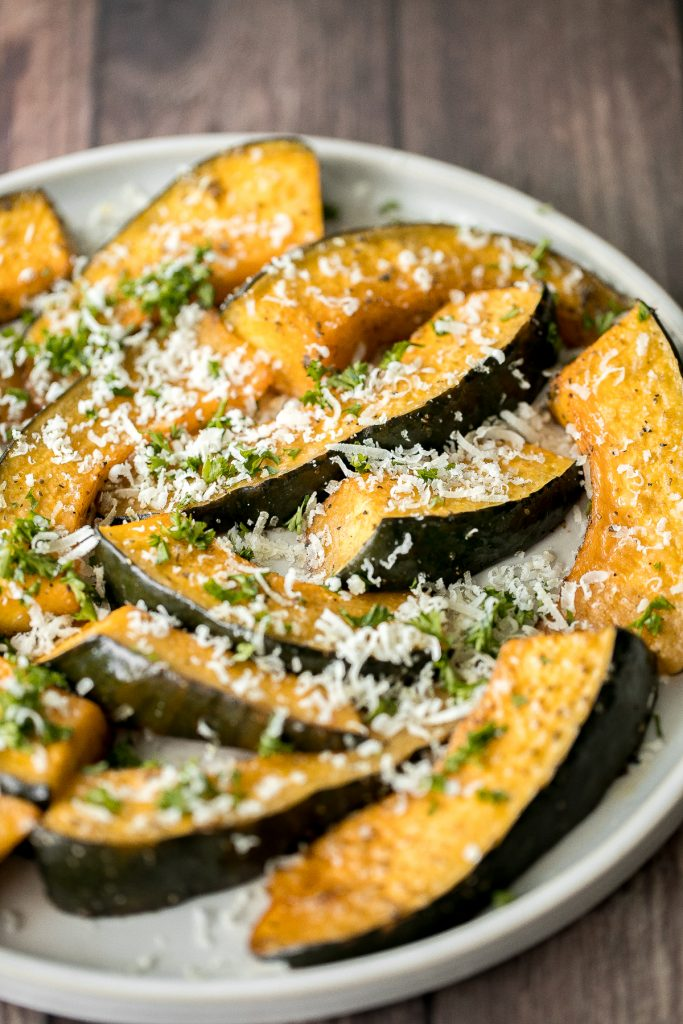Soft and tender, easy roasted pumpkin wedges with Parmesan cheese is the easiest and most delicious side dishes to make this fall. Prep it in just minutes. | aheadofthyme.com