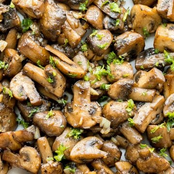 Buttery sautéed garlic mushrooms are silky smooth with an incredible caramelization and earthy rich flavour. A simple side dish in under 15 minutes. | aheadofthyme.com