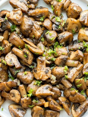 Buttery sautéed garlic mushrooms are silky smooth with an incredible caramelization and earthy rich flavour. A simple side dish in under 15 minutes.   aheadofthyme.com