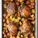 Sheet pan curry chicken and vegetables with tender chicken thighs marinated in a delicious flavourful curry marinade is a complete one pan dinner. | aheadofthyme.com