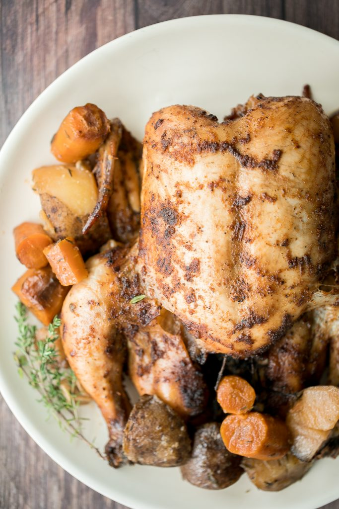 Slow cooker whole chicken is soft and tender and literally falls off the bone. It is the easiest way to cook a rotisserie chicken with a few minutes prep.   aheadofthyme.com