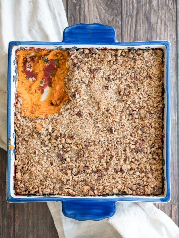 Sweet potato casserole with pecans packed with tender sweet potatoes and a buttery crunchy pecan topping is the best fall side dish for Thanksgiving dinner.   aheadofthyme.com