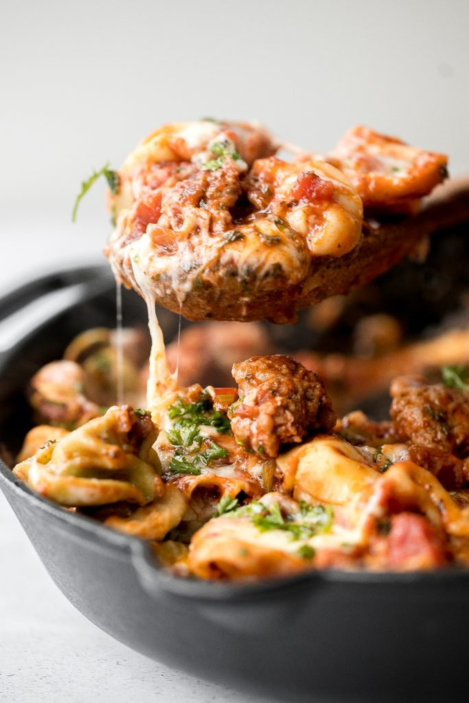 Quick and easy, cheesy tortellini and sausage bake is a delicious 30-minute dinner packed with flavour. A family-favourite comfort food for busy weeknights. | aheadofthyme.com