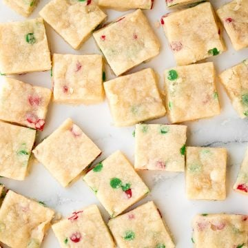 Funfetti Christmas shortbread cookie bites are little bites of buttery melt-in-your-mouth shortbread packed with festive sprinkles for a fun holiday treat. | aheadofthyme.com