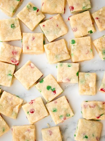 Funfetti Christmas shortbread cookie bites are little bites of buttery melt-in-your-mouth shortbread packed with festive sprinkles for a fun holiday treat.   aheadofthyme.com