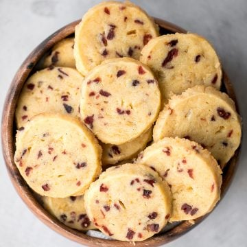 Cranberry orange shortbread cookies are bursting with flavour from dried cranberries and fresh orange zest. These easy cookies are rolled, sliced and baked. | aheadofthyme.com