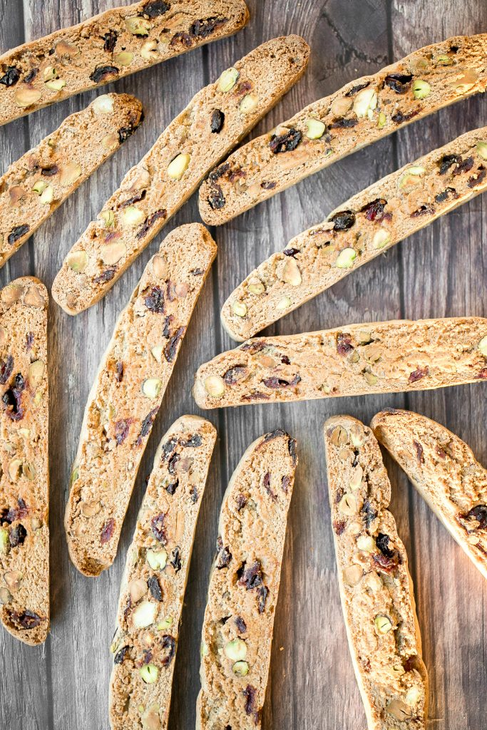 Festive cranberry pistachio biscotti are crunchy, delicious, and perfect for dunking. This Italian cookie is easy to make with warm holiday flavours. | aheadofthyme.com