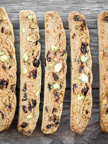 Festive cranberry pistachio biscotti are crunchy, delicious, and perfect for dunking. This Italian cookie is easy to make with warm holiday flavours.   aheadofthyme.com