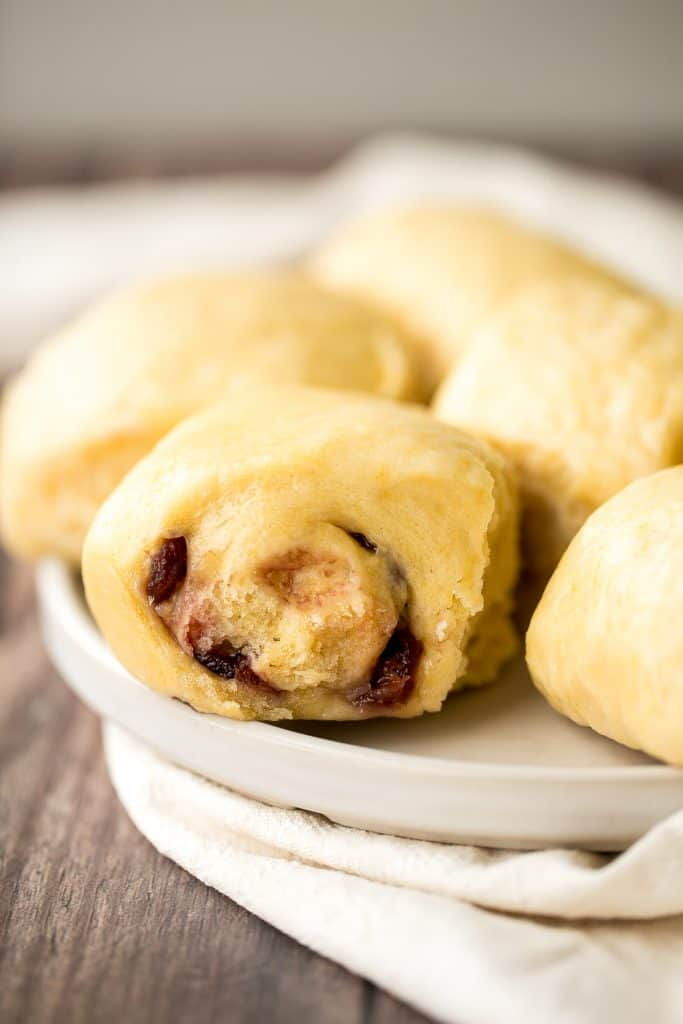 Cranberry pumpkin steamed buns (baozi) are light, spongy, and fluffy Chinese buns packed with colourful cranberries and pumpkin puree for the best flavour. | aheadofthyme.com