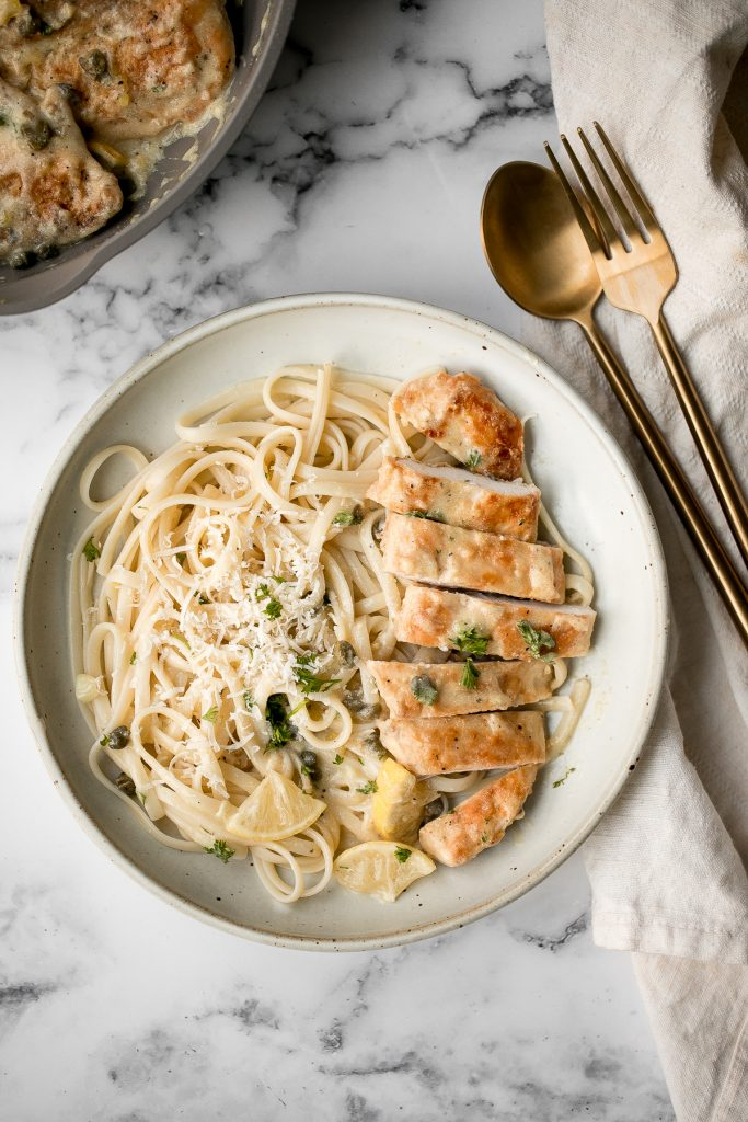 Quick and easy, creamy lemon chicken piccata is a simple and delicious 30-minute meal made with tender chicken breast in a light lemon sauce with capers. | aheadofthyme.com