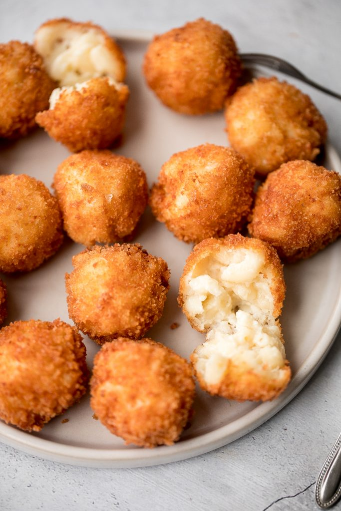 Fried mac and cheese balls are crispy on the outside, creamy and cheesy on the inside, and have the perfect crunch. Best way to use leftover mac and cheese. | aheadofthyme.com