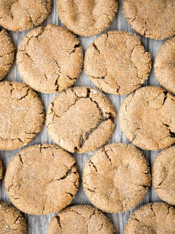 Soft chewy ginger cookies packed with ginger, molasses, and cinnamon spice is the most warm and cozy cookie ever. These holiday cookies stay soft for days.   aheadofthyme.com