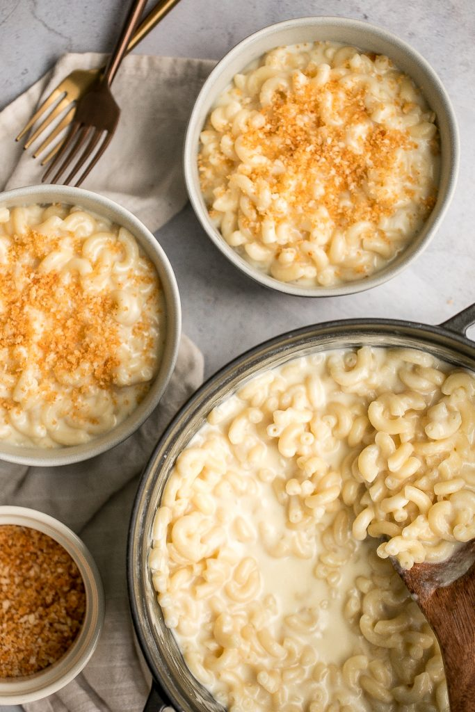 Quick and easy, creamy stovetop mac and cheese with white cheddar is a delicious and comforting one pot 20-minute meal packed with three types of cheese. | aheadofthyme.com