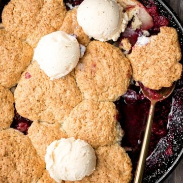Sweet and tart cranberry-apple cobbler with biscuits is packed with fresh fruit and a buttery biscuit topping. This holiday favourite is easy to make. | aheadofthyme.com