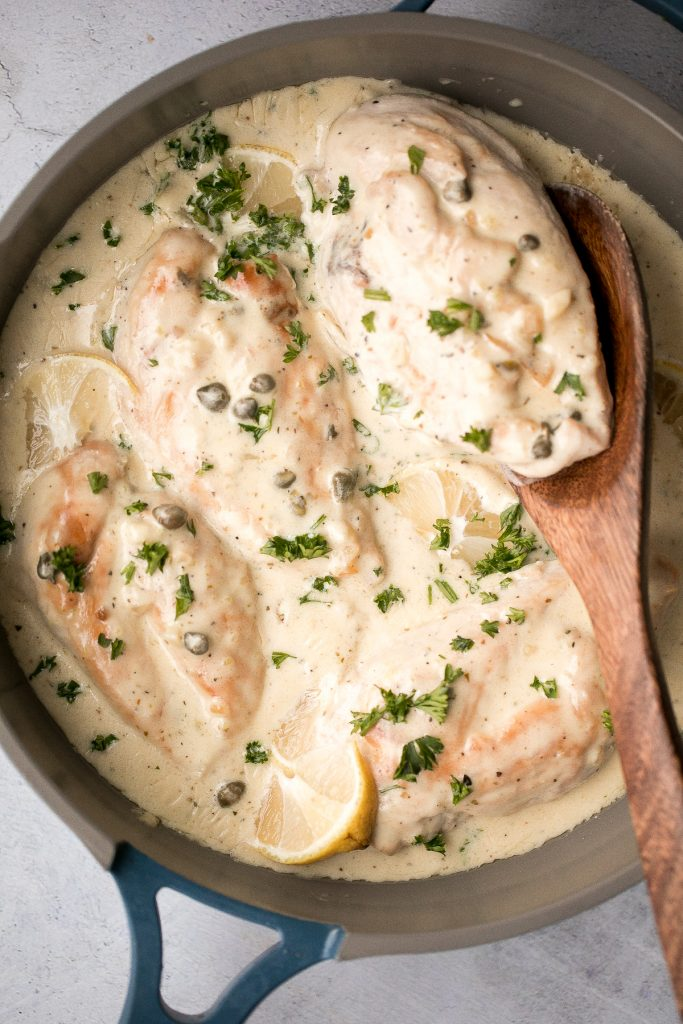 Creamy lemon parmesan chicken is a simple, quick and easy 30-minute meal that is packed with flavour. The most comforting and easiest weeknight dinner. | aheadofthyme.com