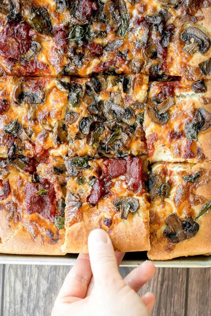 Sheet pan garlic mushroom focaccia pizza with a thick pillowy and crispy crust is topped with sautéed garlic mushrooms, melty mozzarella and lots of basil. | aheadofthyme.com