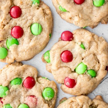 Festive red and green M&M Christmas cookies are super soft and chewy with the crispiest edges. Quick and easy to make in 20 minutes with no chill time. | aheadofthyme.com