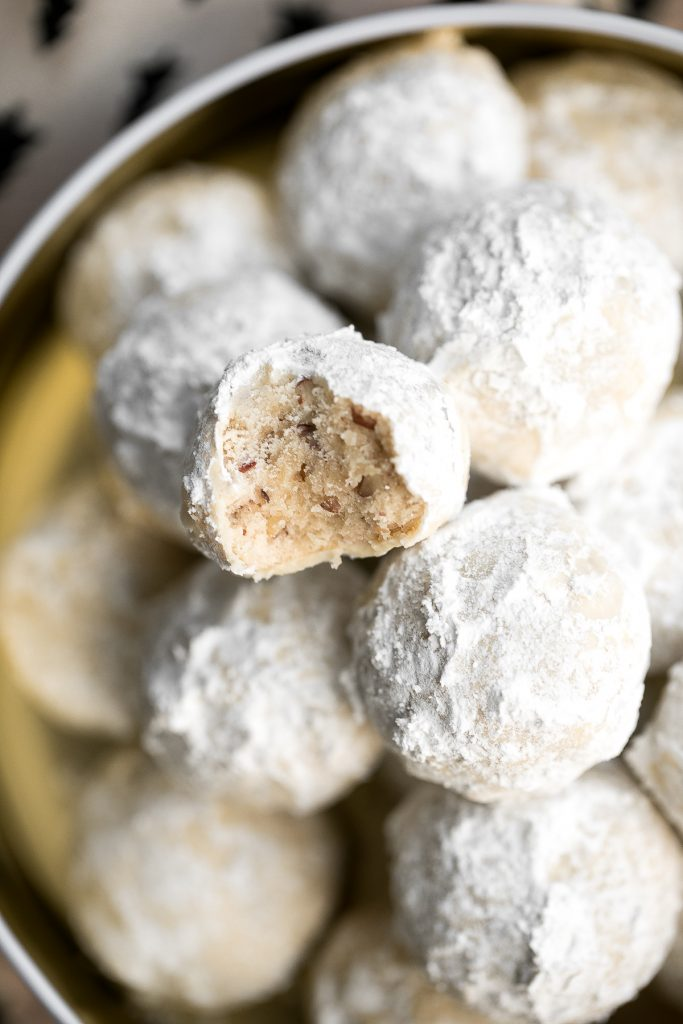 Sweet and nutty pecan snowball cookies (Russian tea cakes or Mexican wedding cookies) are little melt-in-your-mouth balls of buttery shortbread with nuts. | aheadofthyme.com