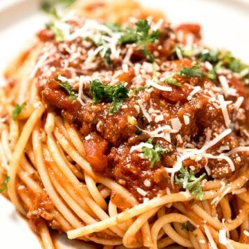 Quick easy spaghetti bolognese with a rich, thick, delicious and flavourful meat sauce is a family favourite ready in 30 minutes. Best weeknight dinner. | aheadofthyme.com