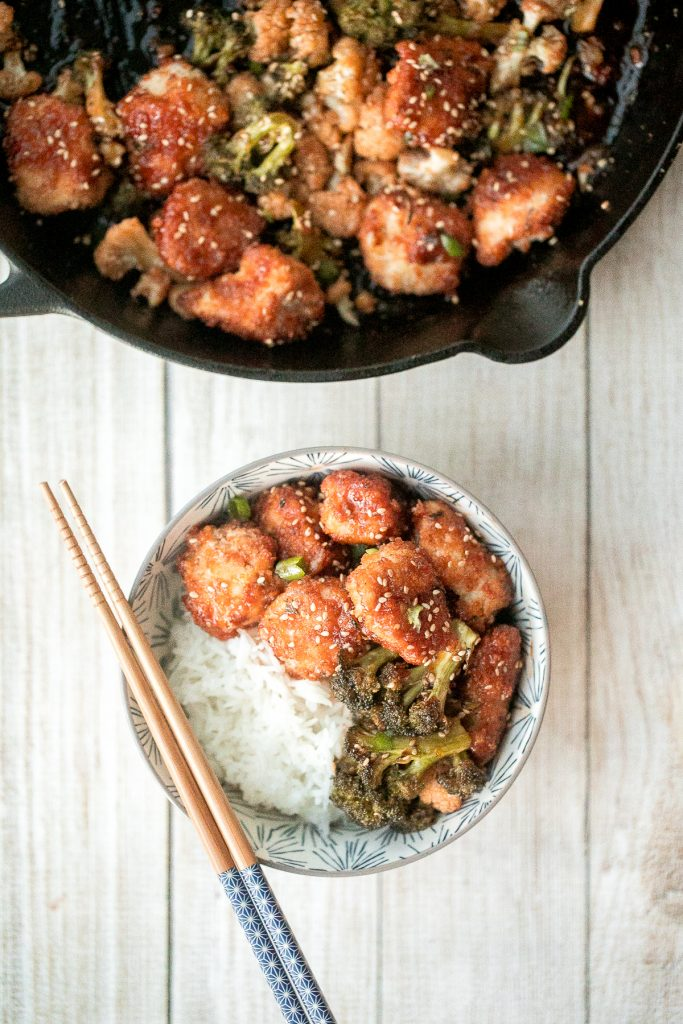 Better than takeout, baked sesame chicken with vegetables is delicious, flavourful, sticky and saucy. This healthier Chinese dish is quick and easy to make. | aheadofthyme.com