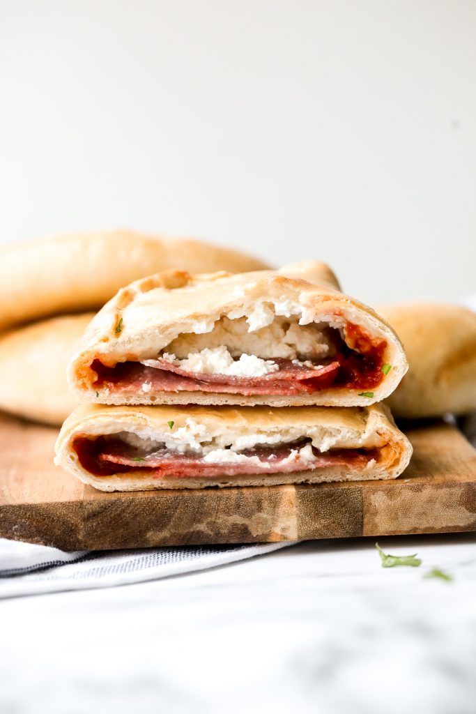 Homemade calzones are delicious little pizza pockets filled with cheese and toppings and baked until golden. This Italian favourite is easy to make at home. | aheadofthyme.com