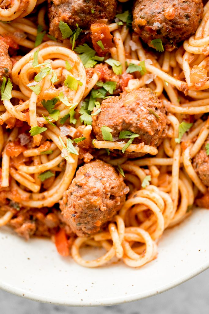Quick and easy spaghetti and meatballs is delicious, rich, comforting with tender beef meatballs simmered in a savoury tomato sauce. Make it in 30 minutes. | aheadofthyme.com