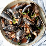 Steamed mussels in tomato sauce is an impressive restaurant-quality dish that is so quick and easy to make at home in less than 25 minutes. | aheadofthyme.com