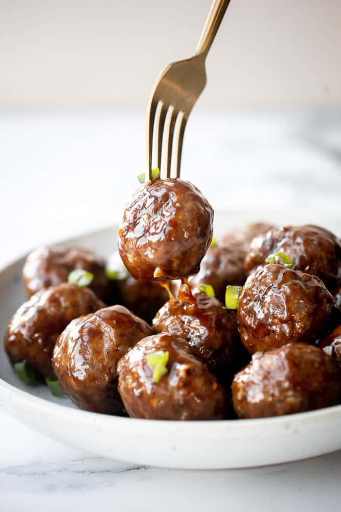 Sticky honey garlic meatballs are a delicious and flavourful 30-minute meal to add to your weekly dinner rotation. A total crowd pleaser. | aheadofthyme.com