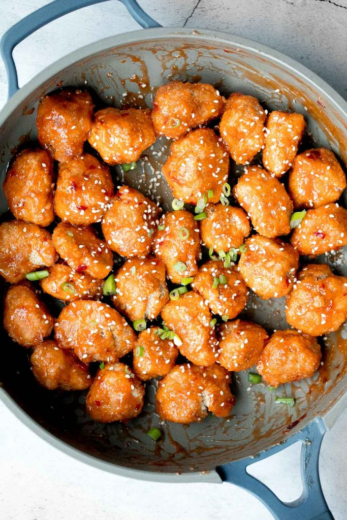 Sticky crispy baked sweet chili chicken bites is better than takeout and so easy to make healthier at home. An easy dinner or game day appy. | aheadofthyme.com