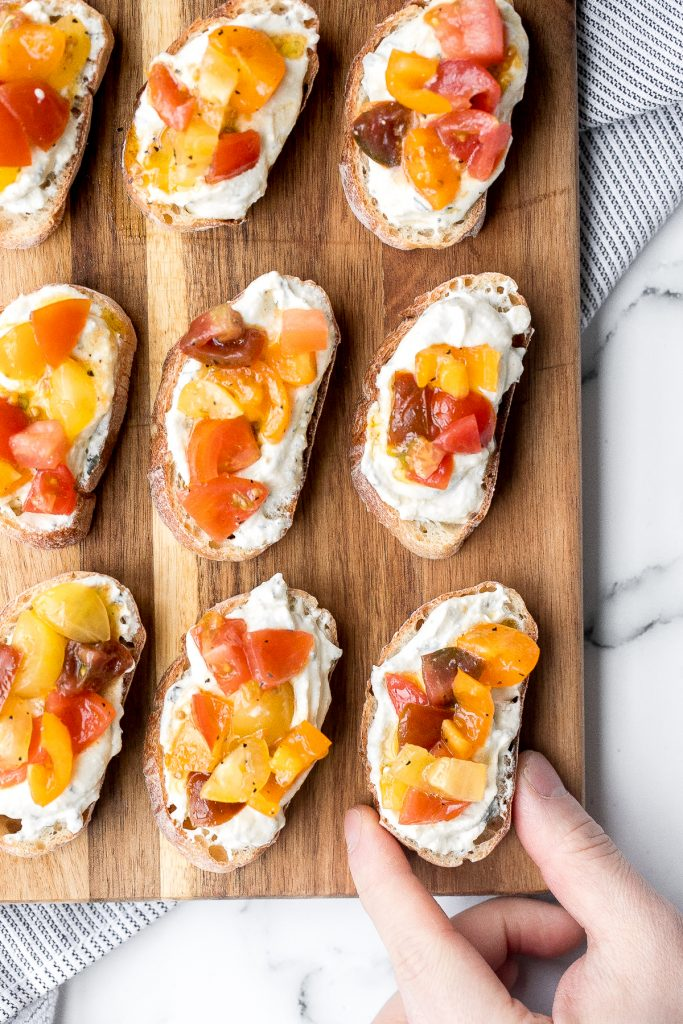 Whipped ricotta crostini is a fancy easy appetizer to make in just minutes or prepare in advance and assemble before serving. A total crowd pleaser. | aheadofthyme.com