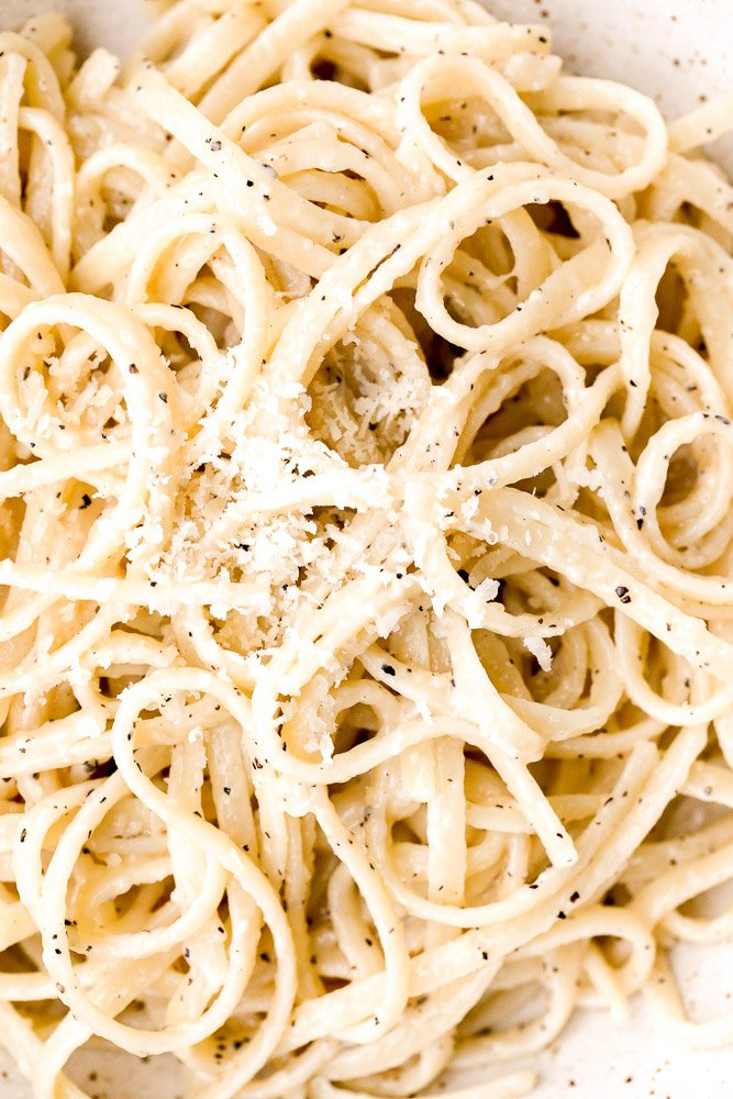 Cacio e pepe is a simple, authentic Italian pasta dish made with just four ingredients in 20 minutes. It's delicious, flavourful and easy to make. | aheadofthyme.com