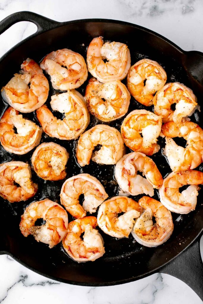 Creamy garlic shrimp is a delicious, quick and easy 15-minute meal (including prep!) that you need to include in your weeknight dinner meal plan. | aheadofthyme.com