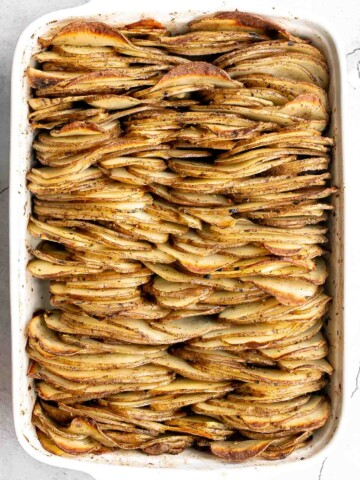 Crispy leaf potatoes are a delicious potato side dish made with layers of buttery, sliced potatoes that crisp up when baked. The perfect side dish.   aheadofthyme.com