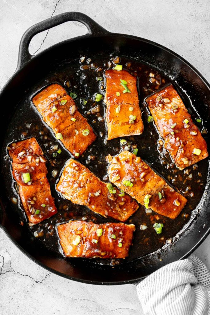 Sticky and sweet, easy honey garlic glazed salmon is one of the best salmon recipes to add to your weeknight dinner rotation. Ready in under 25 minutes.   aheadofthyme.com