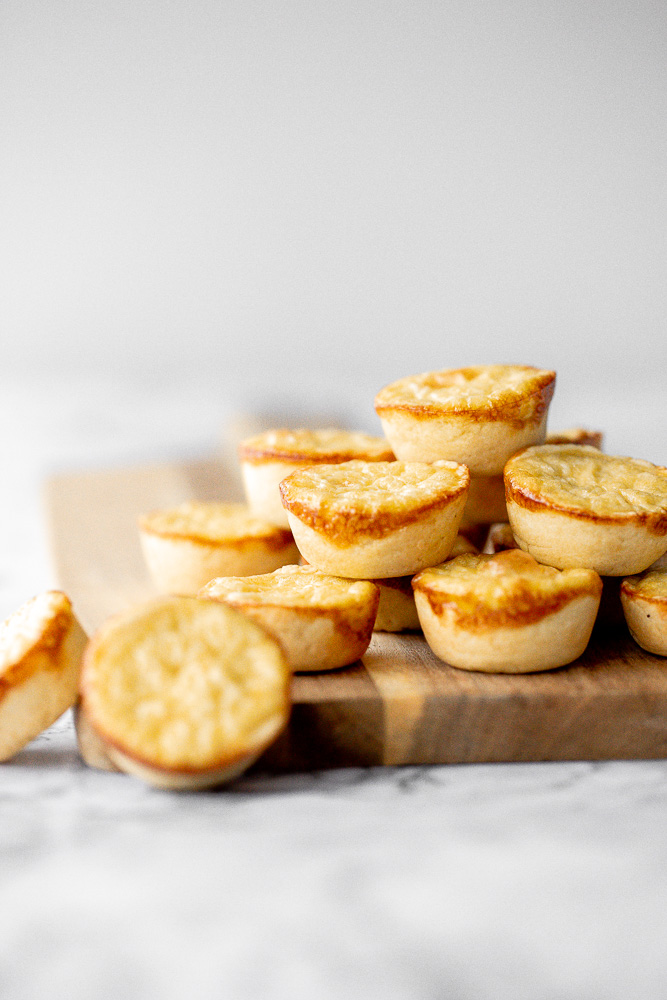 Mini egg tarts with a flaky buttery crust and silky smooth rich egg custard filling are a delicious Hong Kong pastry served as dessert with dim sum. | aheadofthyme.com