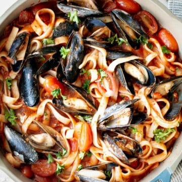 Mussels pasta in tomato sauce is a simple, light and fresh, seafood pasta dinner that you can make at home in 30 minutes. Easiest weeknight dinner. | aheadofthyme.com
