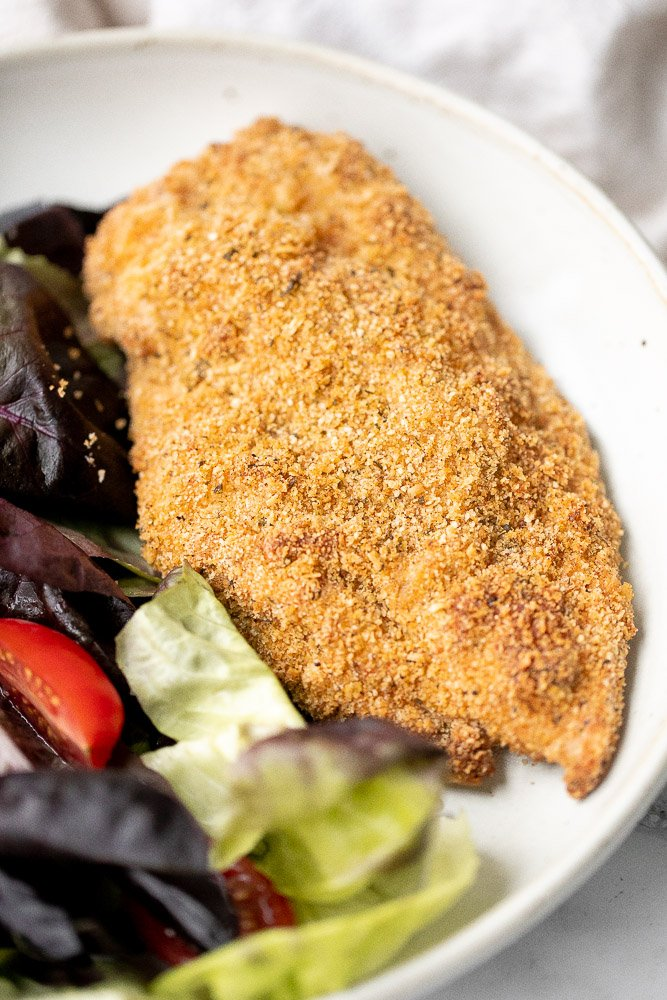 Baked parmesan crusted chicken is breaded in a herby parmesan breadcrumb mixture and baked until crispy perfection. So flavourful and delicious. | aheadofthyme.com