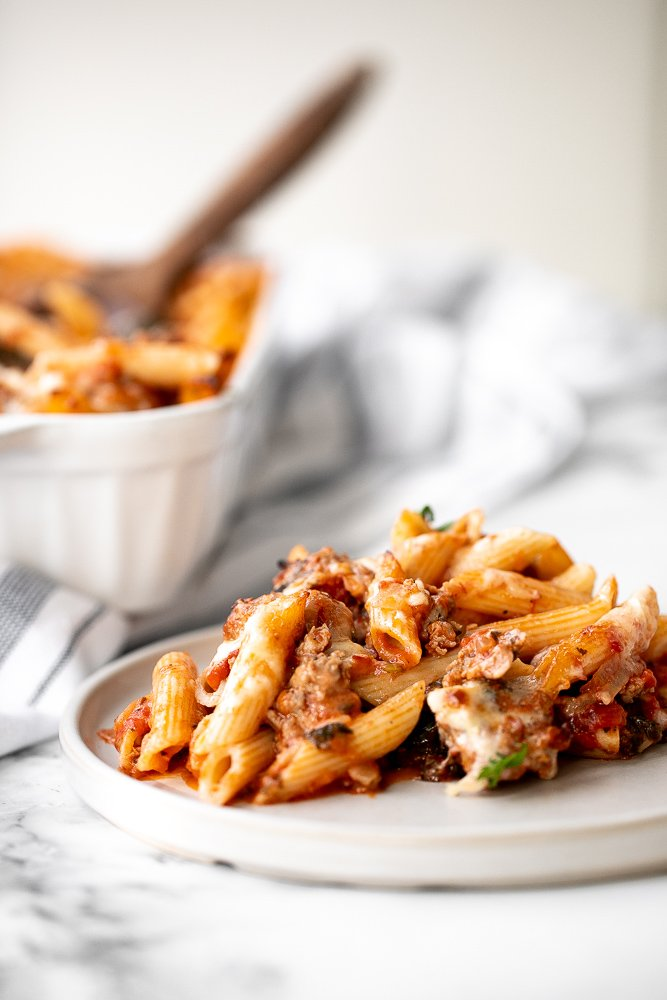Pasta bake with sausage (baked ziti) is a lazy day lasagna with layers of pasta tossed in a rich meat sauce, layered with mozzarella, and baked. | aheadofthyme.com