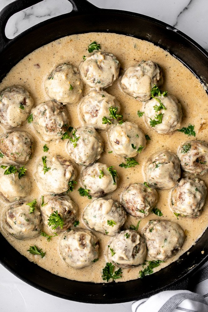 Delicious, comforting homemade Swedish meatballs are seared and smothered in a creamy gravy sauce and taste so much better than IKEA meatballs.   aheadofthyme.com