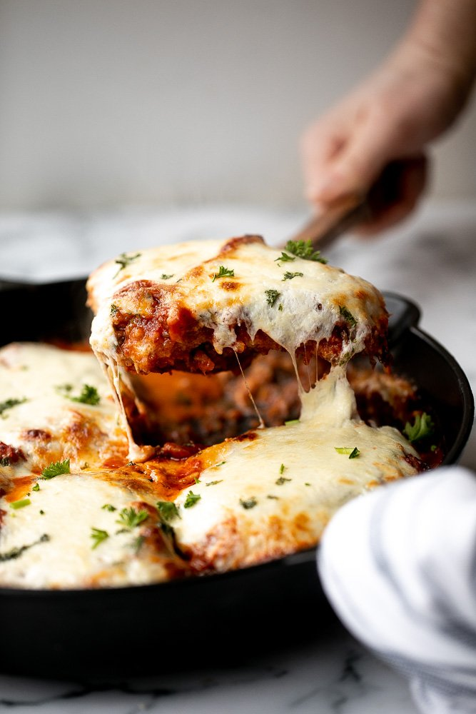 Baked turkey parmesan with a delicious, crispy, breaded coating covered in a rich homemade tomato sauce and topped with melted mozzarella and parmesan. | aheadofthyme.com
