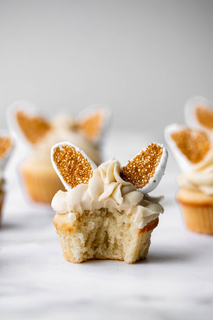 Get festive with these cute bunny ears Easter cupcakes. Buttercream frosting and marshmallows make these vanilla cupcakes extra sweet and delicious.   aheadofthyme.com