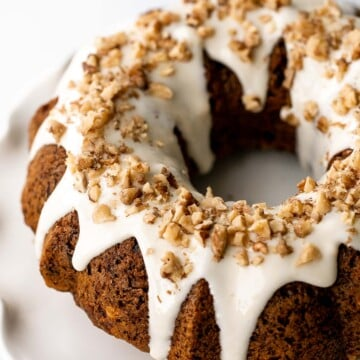 Showstopping carrot bundt cake with cream cheese glaze is light, fluffy, and moist. It's loaded with sugar, spice, and everything nice. | aheadofthyme.com