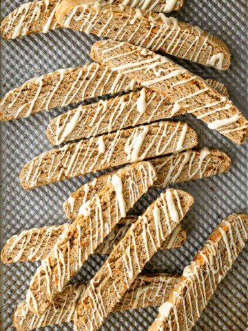 Carrot cake biscotti is crunchy, crumbly, and satisfies all your carrot cake cravings. Enjoy these Italian cookies as is or with white chocolate. | aheadofthyme.com