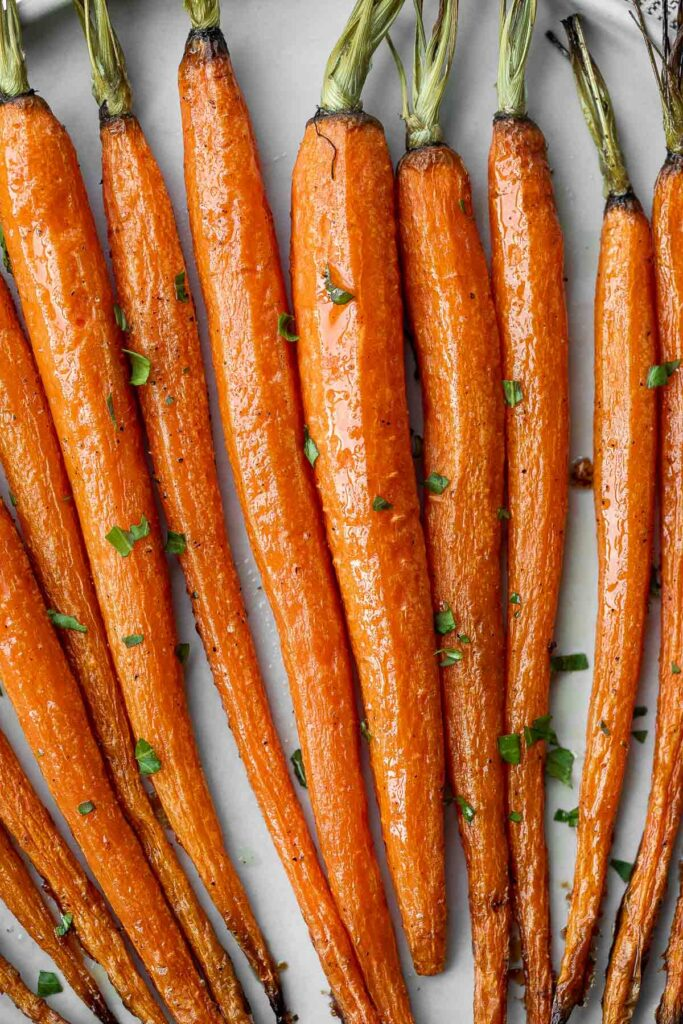 Honey roasted carrots are a sweet, savoury, and salty side dish that pairs well with almost any entree. With these flavours, everyone will want seconds. | aheadofthyme.com