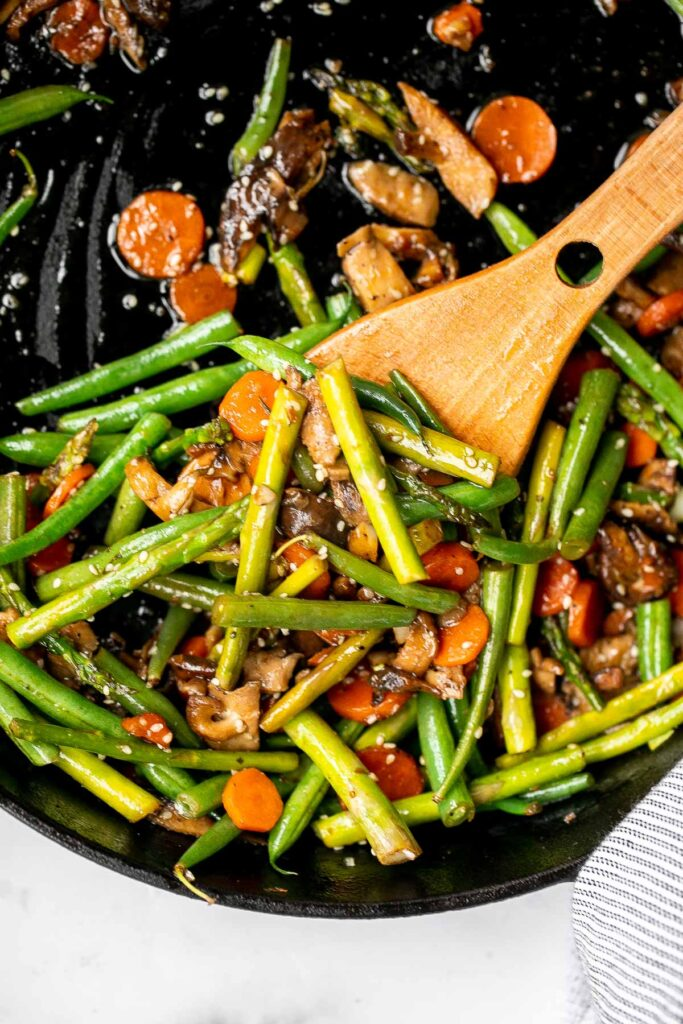 Quick and easy spring vegetable stir fry is made with delicious seasonal vegetables, packed with savoury and salty flavour, and takes 10 minutes to cook. | aheadofthyme.com