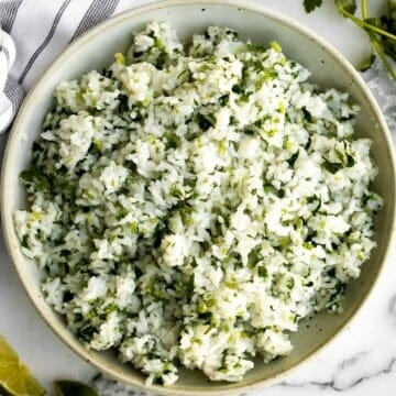 Cilantro lime rice is a fresh, bright and vibrant side dish that will add extra flavour to any meal you serve it with. It's a quick, easy, one pot recipe. | aheadofthyme.com