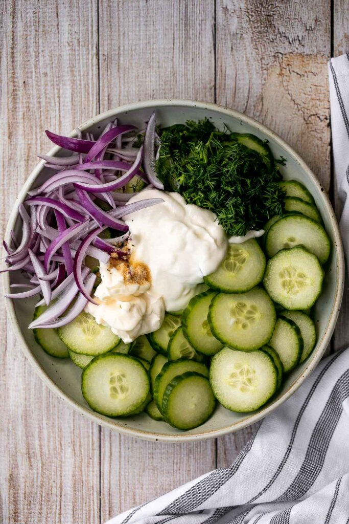 This creamy cucumber salad is the easy, refreshing snack and side dish your summer cookouts have been missing. Make it ahead with just 5 minutes prep. | aheadofthyme.com