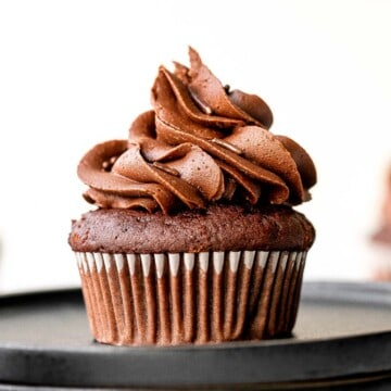 Moist chocolate cupcakes topped with chocolate buttercream frosting and sprinkles, are a chocolate triple threat. They're rich, decadent, sweet, and easy. | aheadofthyme.com