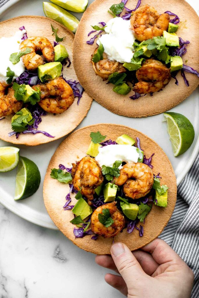 Shrimp avocado tostadas are a delicious, crunchy, quick and easy Mexican dish you can make in just 15 minutes, loaded with the best combination of toppings. | aheadofthyme.com