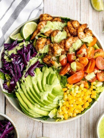 Shrimp taco salad with cilantro lime dressing is flavourful, delicious, and easy to make. It has all the fixings and of shrimp tacos, but without the mess. | aheadofthyme.com